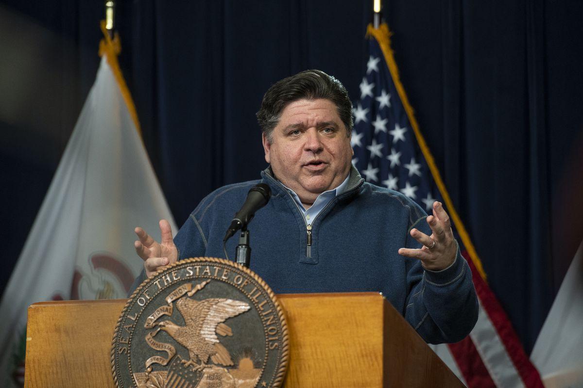 Gov. J.B. Pritzker speaks at a news briefing in April.