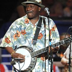 FILE - In this May 3, 2009, file photo, Taj Mahal performs at a benefit concert celebrating Pete Seeger's 90th birthday at Madison Square Garden in New York. The artist known as Taj Mahal, who has played an average of 125 concerts a year since 1968, turns 70 somewhere on the road between Kansas and Colorado in May. But his next stop is Alaska, a place he first visited sometime in the 1970s and a place he has returned routinely since. Two things keep him coming back: the fish and the widespread appreciation for a musician who travels this far north and stops somewhere besides Anchorage.