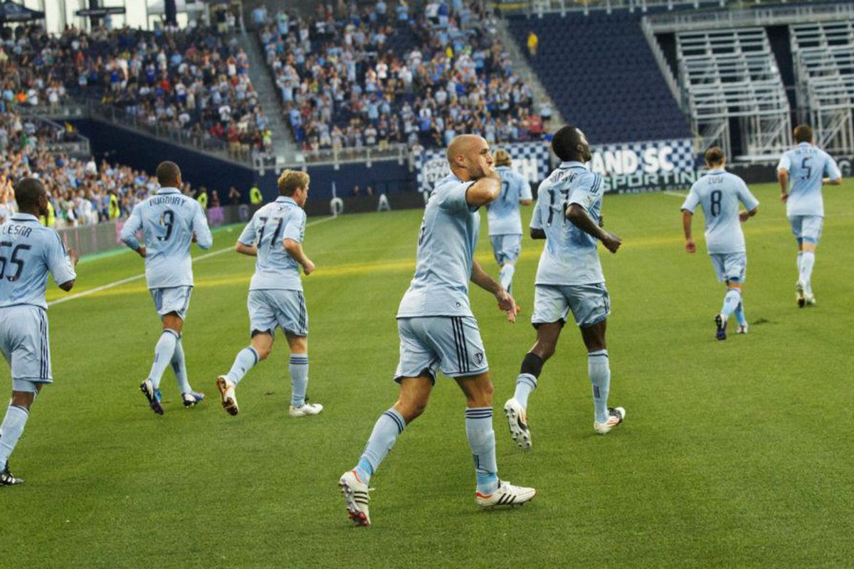 (Gary Rohman Photography - Photo courtesy of Sporting KC) Collin and some other Sporting KC players celebrating the opening goal.