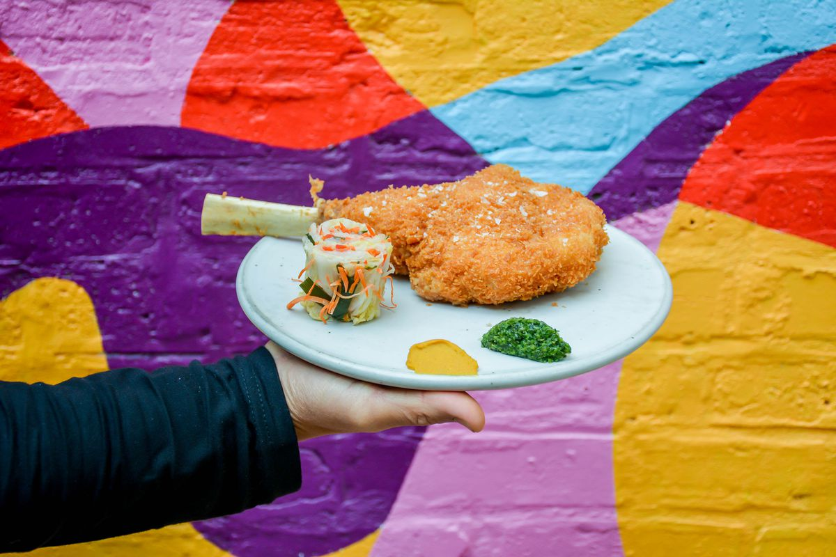 A plate with a large tonkatsu on it.