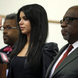 Former Miss USA Rima Fakih, center, stands before the court with city attorney Todd Russell Perkins, left and her attorney Otis Culpepper, for her drunken driving case at 30th District Court in Highland Park, Mich., on Wednesday, April, 11, 2012.  A trial had been planned before 30th District Court Judge Brigette Officer on the original charges of drunken driving, careless driving and having an open container of alcohol, all misdemeanors. Fakih pleaded no contest.
