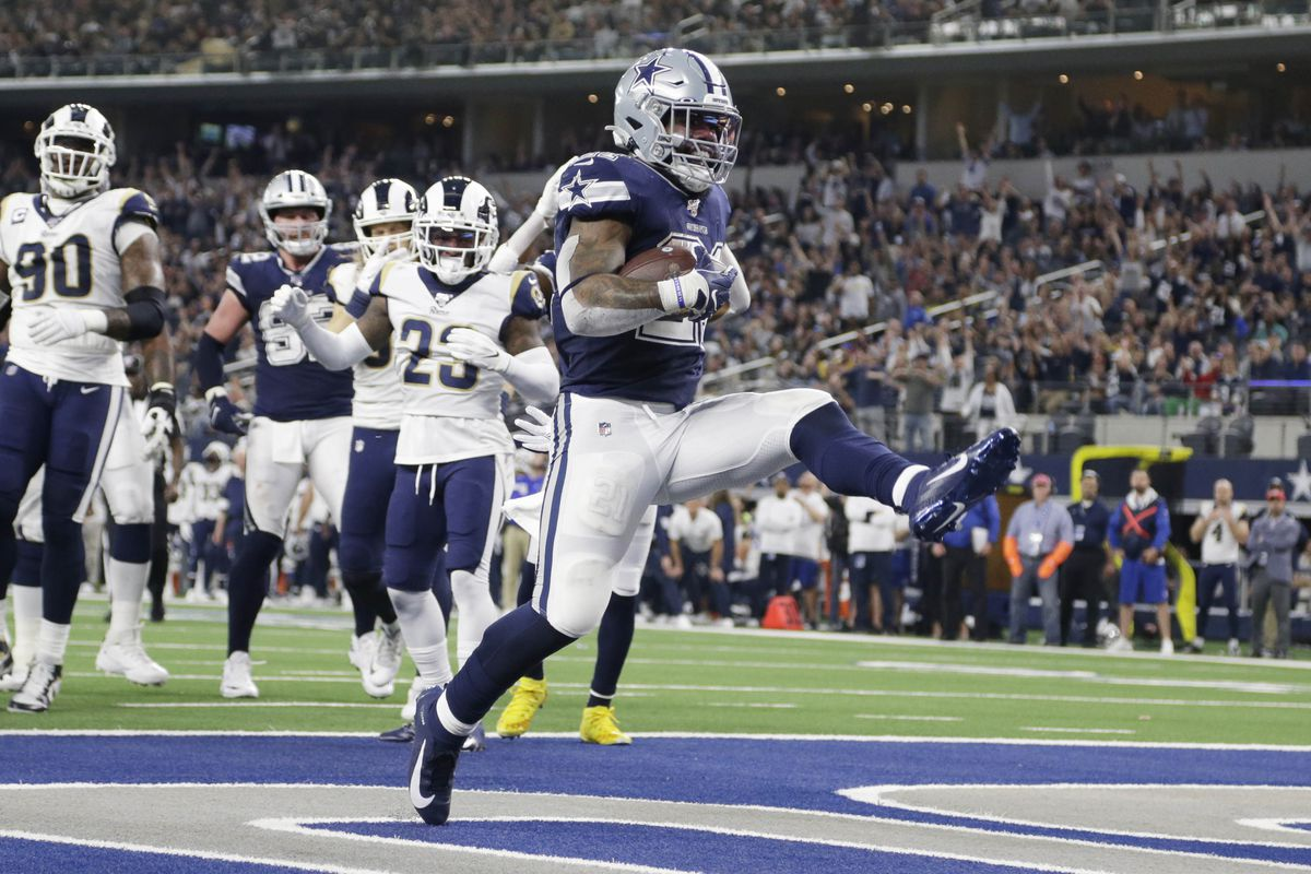 Dallas Cowboys running back Ezekiel Elliott scores a touchdown in the second quarter against the Los Angeles Rams at AT&T Stadium.