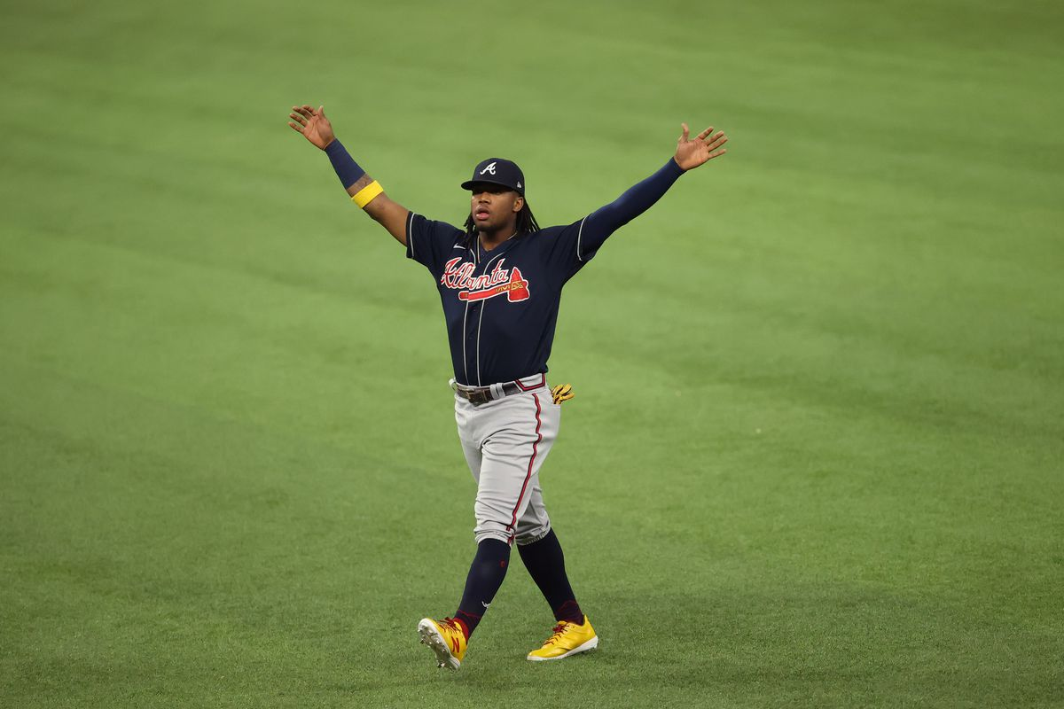 Atlanta Braves right fielder Ronald Acuna Jr. warms up before game seven of the 2020 NLCS against the Los Angeles Dodgers at Globe Life Field.