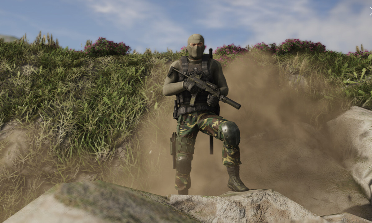 A masked soldier with green camouflage pants stands on a rock outcropping with a cloud of dust behind him.