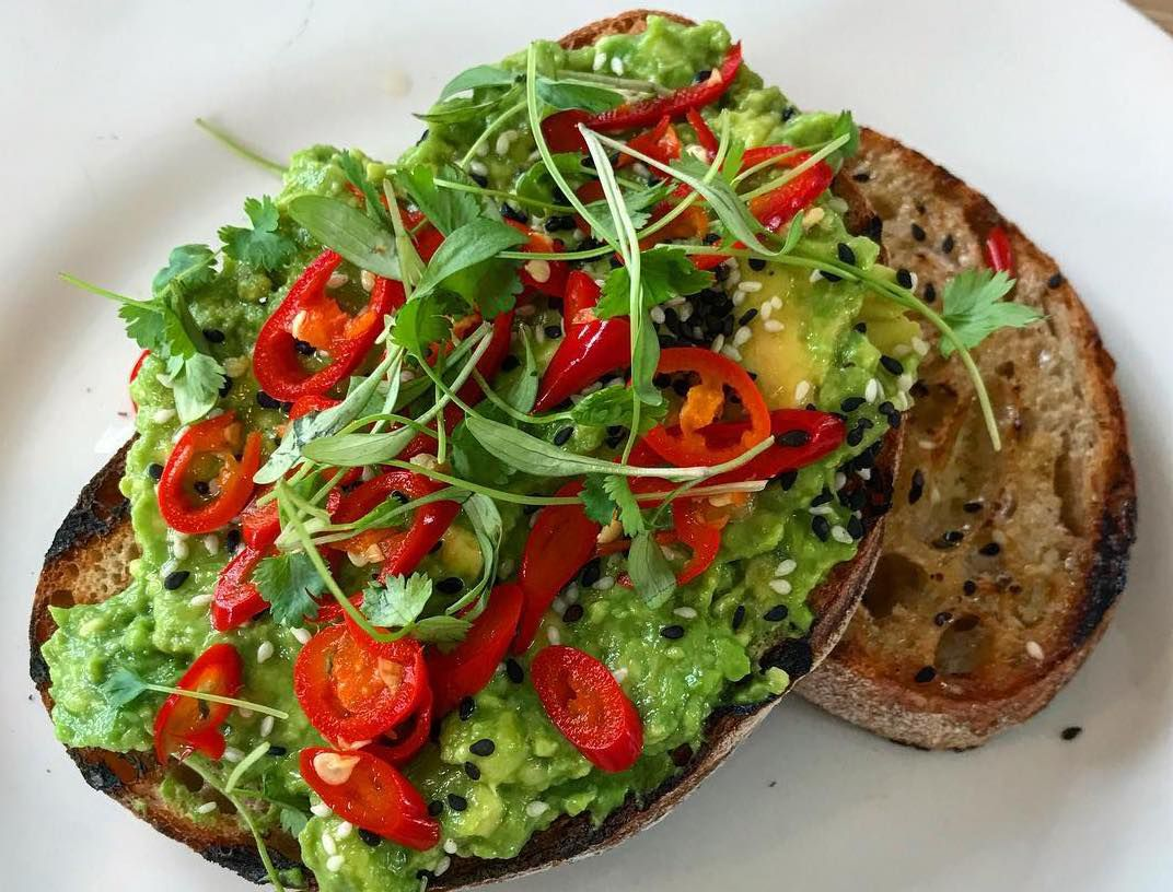 Avocado and chilli on toast at The Lido Cafe in Brockwell Park, London, one of London's best waterside restaurants
