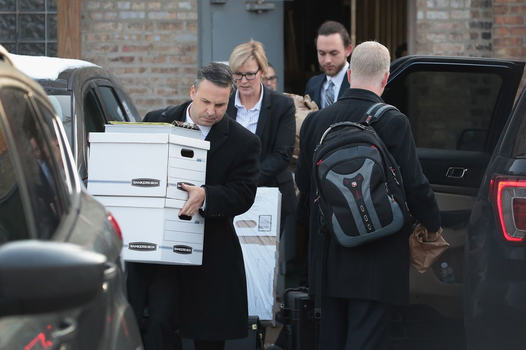 Federal agents remove computer equipment and document boxes from the Southwest Side office of 14th Ward Alderman last year. File Photo.