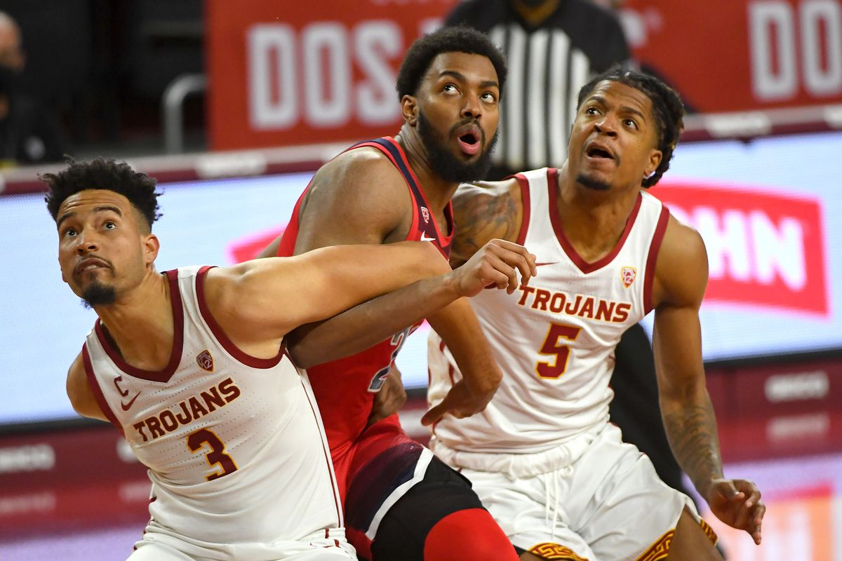 USC Trojans forward Isaiah Mobley and USC Trojans guard Isaiah White box out Arizona Wildcats forward Jordan Brown under the basket in the second half of the game at Galen Center.