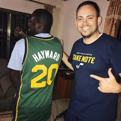 Zach Harding, right, poses with the Isaac Sarpong in his new (donated) Gordon Hayward jersey. The Sarpong family takes care of the World Joy's guest house Abomosu, Ghana, throughout the year.
