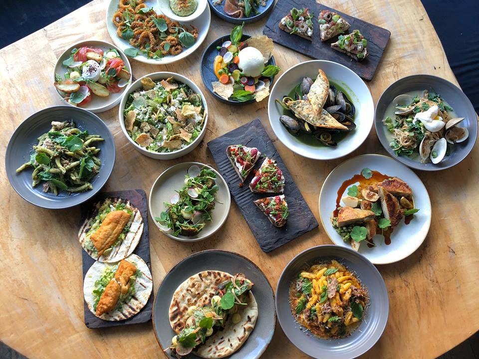 A spread of Puritan & Co. food