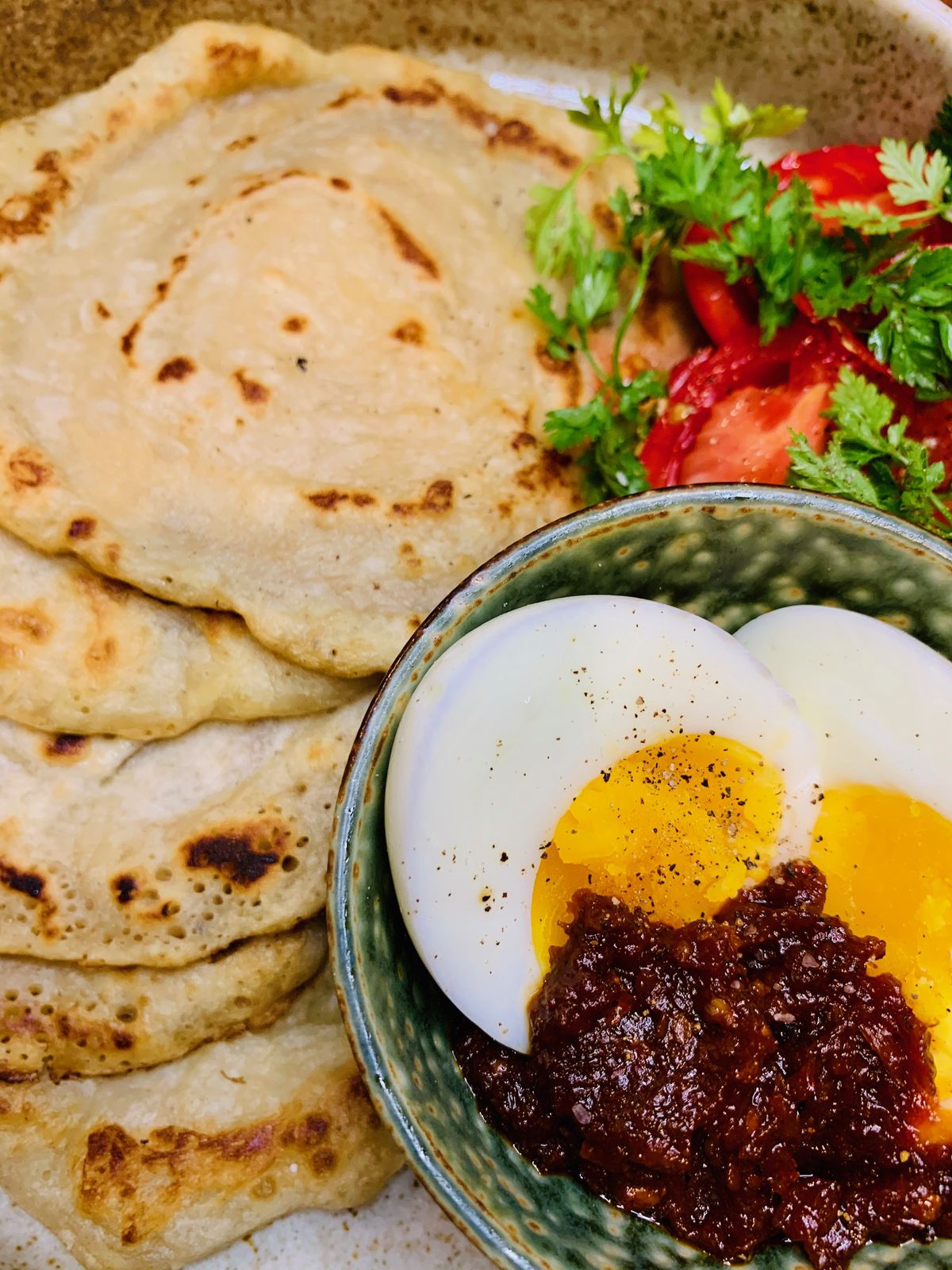Lempeng kelapa (coconut pancakes) with eggs and Mexican-inspired sambal