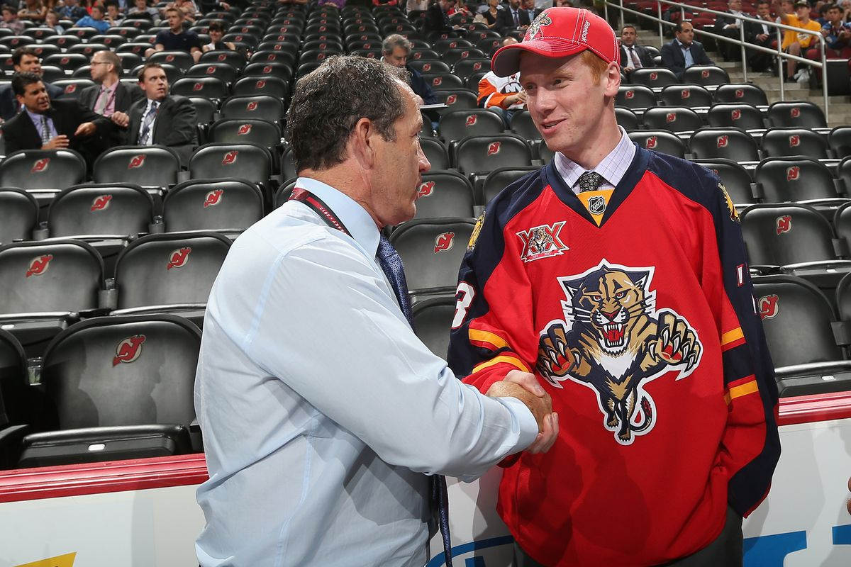 Future North Dakota goalie Evan Cowley shakes the hand of the Florida Panthers Head Coach Kevin Dineen