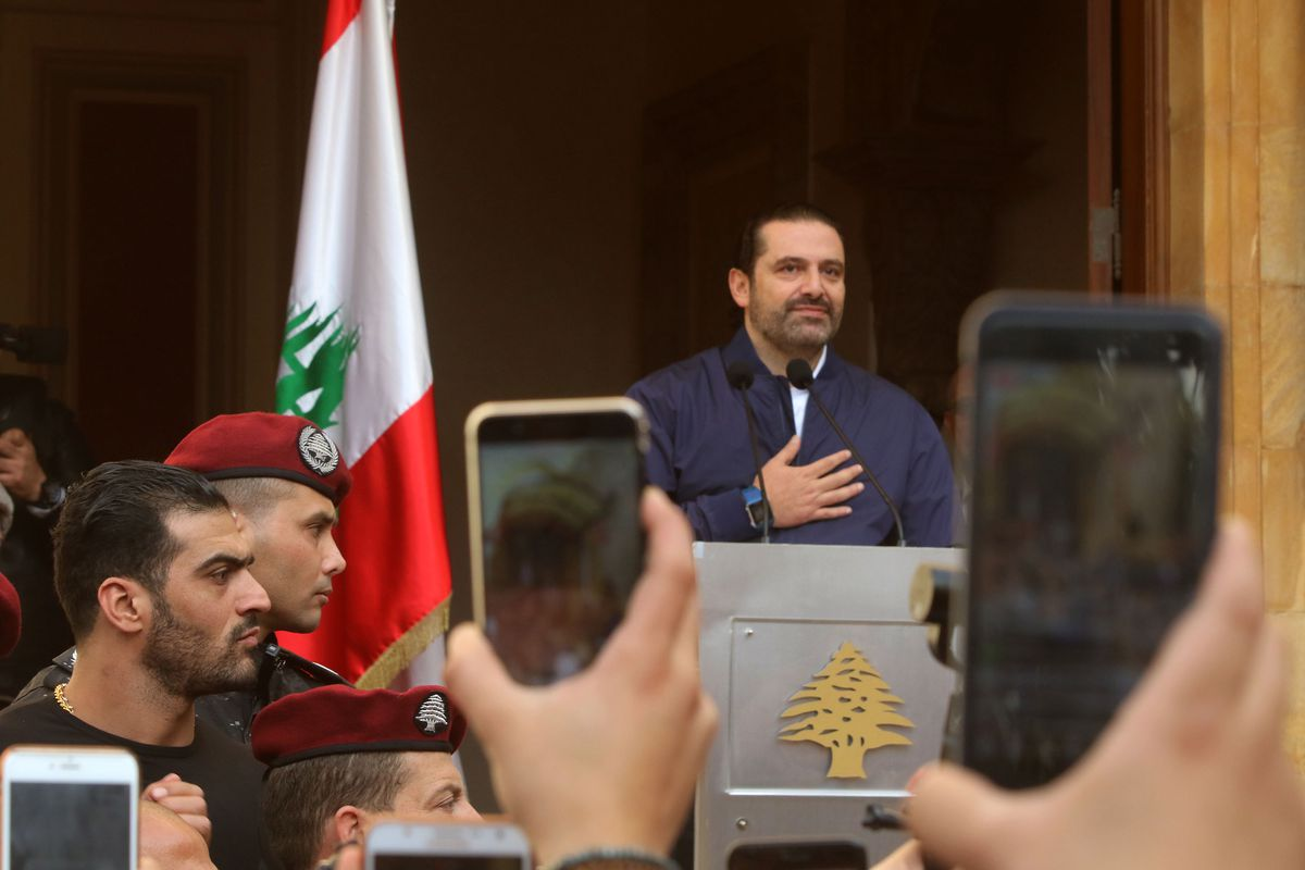"""BEIRUT, LEBANON- NOVEMBER 22:  Lebanon's Prime Minister Saad Hariri makes a public appearance at his home """"Beit al-Wasat"""" November 22, 2017 in Beirut, Lebanon. Hariri arrived early Wednesday to participate in the official celebration of Lebanese Independence Day and to meet with President Michel Aoun after Hariri's shocking resignation announcement in Riyadh last week, which sparked accusations that was being held in Saudi Arabia against his will. Hariri has changed his mind and decided not to resign. (Photo by Salah Malkawi/ Getty Images)"""