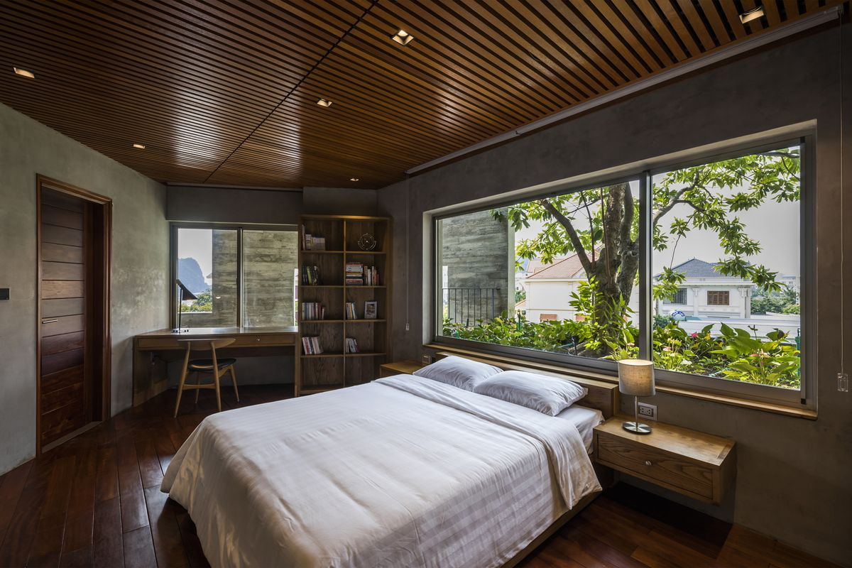 Bedroom clad in timber and concrete.