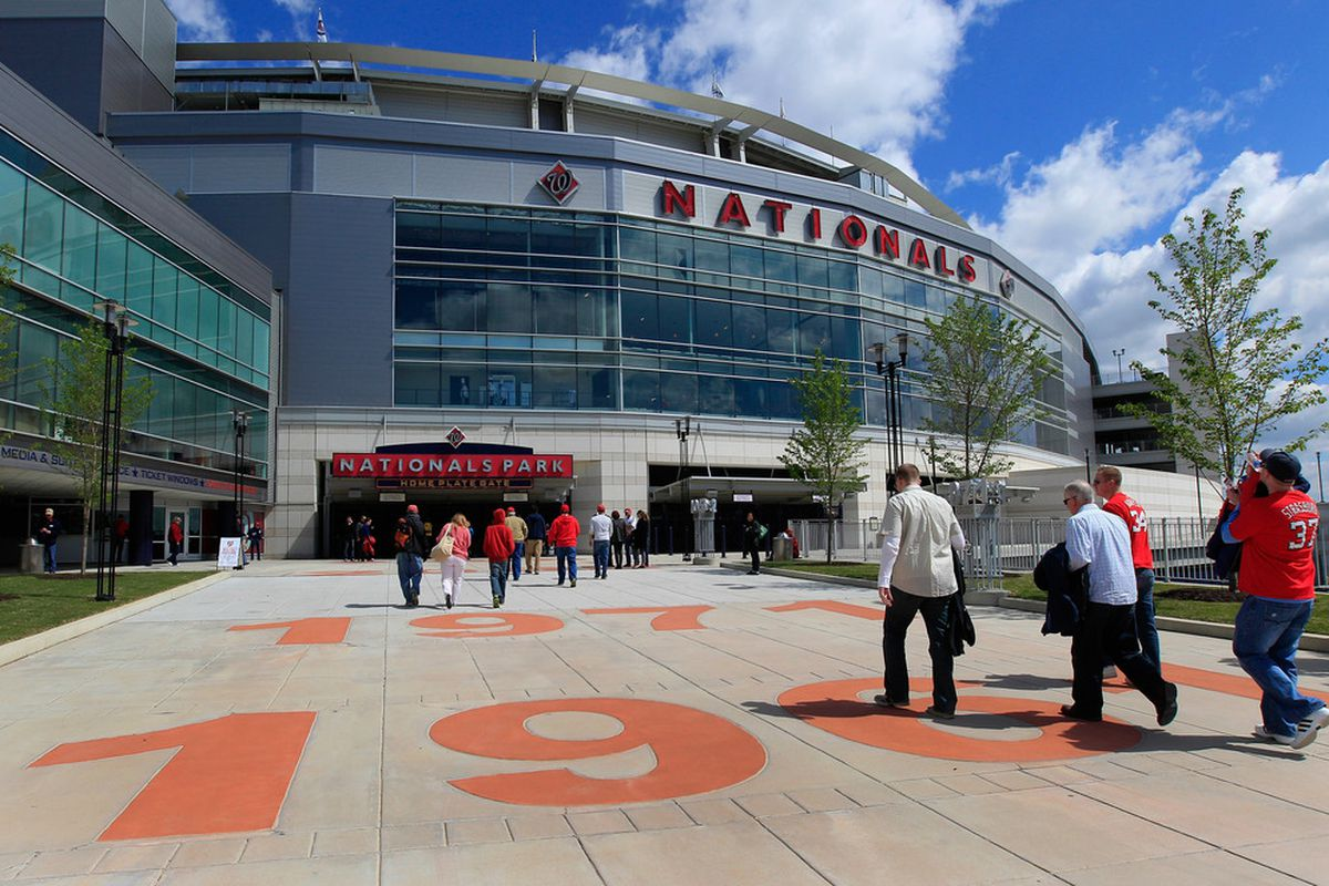 WASHINGTON, DC - APRIL 12: Fans enter Nationals Park during openinig day between the Cincinnati Reds and Washington Nationals on April 12, 2012 in Washington, DC.  (Photo by Rob Carr/Getty Images)