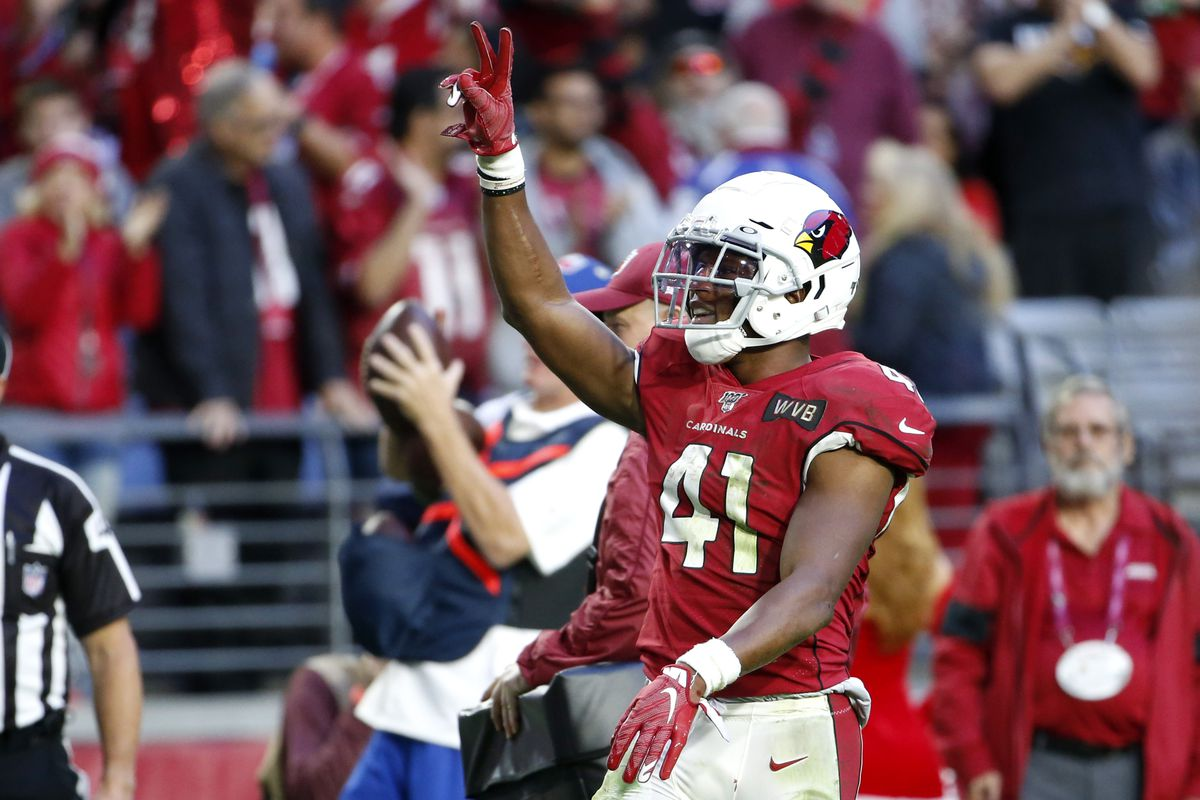 Running back Kenyan Drake #41 of the Arizona Cardinals gestures to the crowd after scoring a touchdown against the Cleveland Browns during the second half of the NFL football game at State Farm Stadium on December 15, 2019 in Glendale, Arizona.