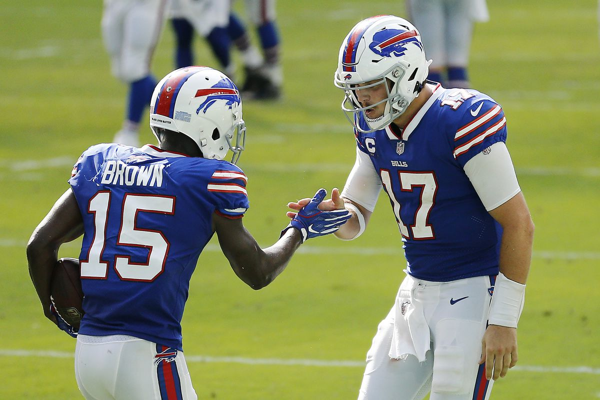 Josh Allen #17 of the Buffalo Bills celebrates with John Brown #15 after a 46-yard touchdown during the fourth quarter at Hard Rock Stadium on September 20, 2020 in Miami Gardens, Florida.