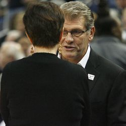 UConn head coach Geno Auriemma talks with Notre Dame head coach Muffet McGraw before the Notre Dame Fighting Irish vs UConn Huskies women's college basketball game in the Women's Jimmy V Classic at the XL Center in Hartford, CT on December 3, 2017.