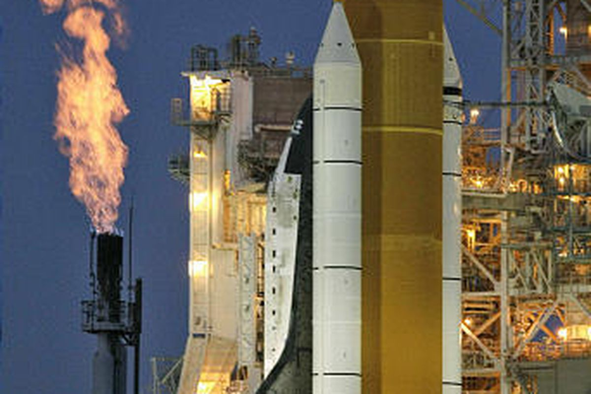 A furnace burns extra fuel near the shuttle Discovery Monday in Cape Canaveral, Fla.