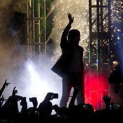 WBO welterweight champion boxer Manny Pacquiao, of the Philippines, waves as fireworks explode behind him during a boxing presentation in Mexico City, Friday, Sept. 21, 2012. Pacquiao and his Mexican challenger Juan Manuel Marquez are promoting their fourth fight, scheduled for Dec. 8, 2012 in Las Vegas.