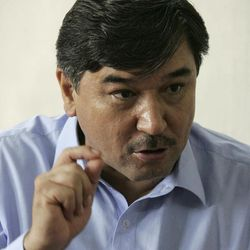 """In this Wednesday, Sept. 5, 2012 photo, Abdul Khaliq Hazara, leader of the Hazara Democratic Party Shiite Muslim's gestures during an interview in Pakistan's violent Baluchistan capital of Quetta, Pakistan, where radical Sunni Muslim rivals have terrorized and murdered minority Shiites in a wave of suicide bombings and target killings. Hazara said at his home in Quetta: """"From law enforcement, government or any institution we are 100 percent disappointed."""""""