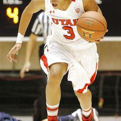 Utah's Iwalani Rodrigues pushes the ball up court after a steal as Utah and Utah State play Nov. 27, 2012, in the Huntsman Center. Utah won 92-64.