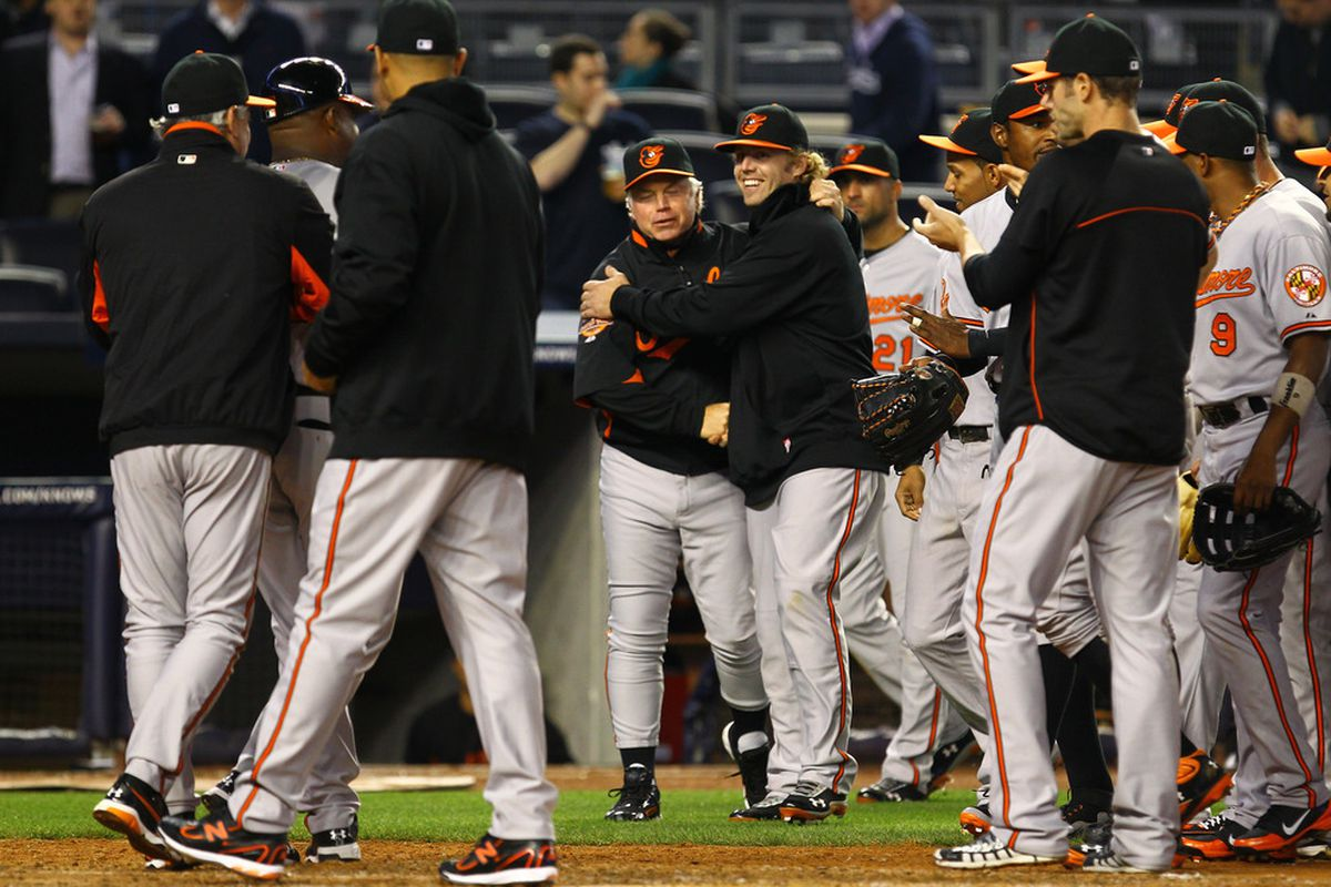 Buck Showalter,Manager of the Baltimore Orioles is met by his teamates after winning his 1000th career Major League game against the New York Yankees during their game on May 1, 2012 at Yankee Stadium in the Bronx borough of New York City.