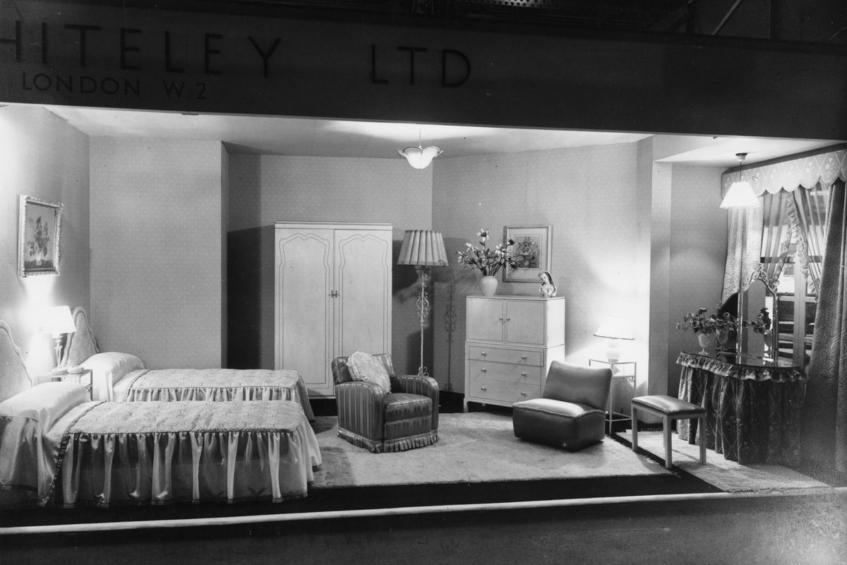 """A furniture showroom circa 1930 showing an """"ideal bedroom."""""""