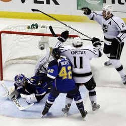 Los Angeles Kings' Matt Greene (2) celebrates after scoring past St. Louis Blues goalie Brian Elliott, left, as David Backes (42) and Kings' Anze Kopitar, of Slovenia, watch during the second period of Game 1 in a second-round NHL Stanley Cup hockey playoff series, Saturday, April 28, 2012, in St. Louis.