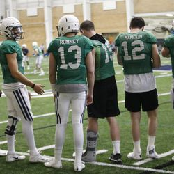 Brigham Young Cougars quarterbacks watch play during an intersquad scrimmage in Provo on Friday, March 23, 2018.