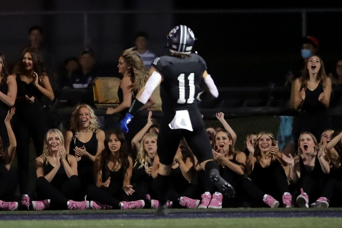 Corner Canyon dancers cheer as Jett Meine runs into the end zoneduring a high school football game at Corner Canyon in Draper on Friday, Sept. 24, 2021. Corner Canyon won 38-23.