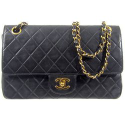 """Chanel Quilted Double Flap Bag from the '90s, <a href=""""http://www.shopdecadesinc.com/shop/viewproduct/7292"""" target=""""_blank"""">$3,300</a>. """"This is a total investment piece. Chanel bags always increase in value."""""""