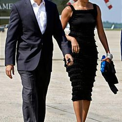 President Barack Obama and first lady Michelle Obama walk towards Air Force One at Andrews Air Force Base, Md.  The Obamas are edging out Hollywood stars on Vanity Fair's International Best-Dressed List.