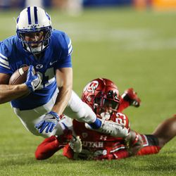 Brigham Young Cougars wide receiver Talon Shumway (21) dives for yardage on the tackle by Utah Utes defensive back Julian Blackmon (23) in Provo on Saturday, Sept. 9, 2017.