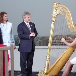 Elizabeth Smart plays the harp for her parents Ed and Lois Smart and John Walsh during the taping of the John Walsh Show in Washington, Wednesday, April 30 2003  The nationally syndicated daytime talk show airs Friday May 2.