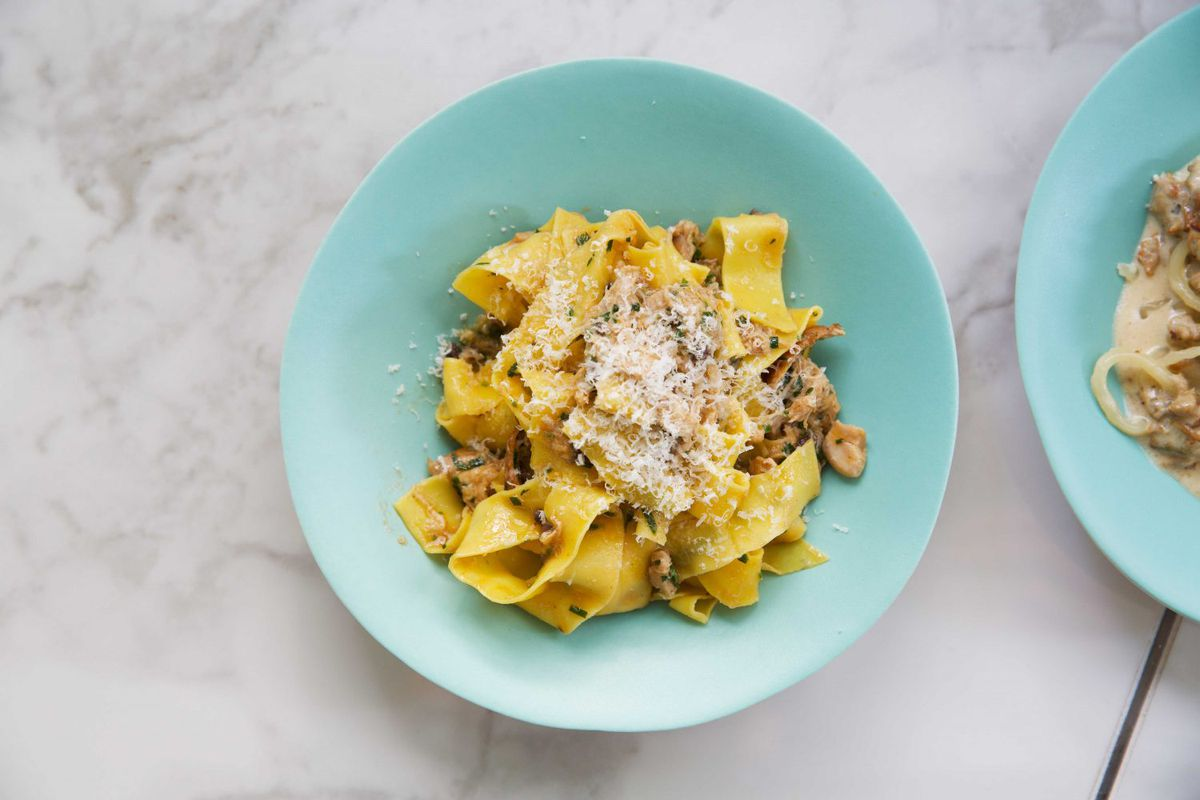 A turquoise bowl of pasta at Lina Stores in Soho