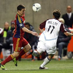 Will Johnson of Real Salt Lake battles for control of the ball against Brian Mullan of the Colorado Rapids during their MLS match up at Rio Tinto Stadium in Sandy Saturday, April 7, 2012.