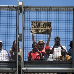 People watch the march from a Dan Ryan overpass.   Ashlee Rezin/Sun-Times