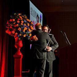 Last year's winner Todd Gray presents Rasika's Vikram Sunderam with the Chef of the Year award.