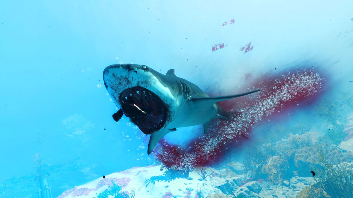 a shark eating a human in Maneater