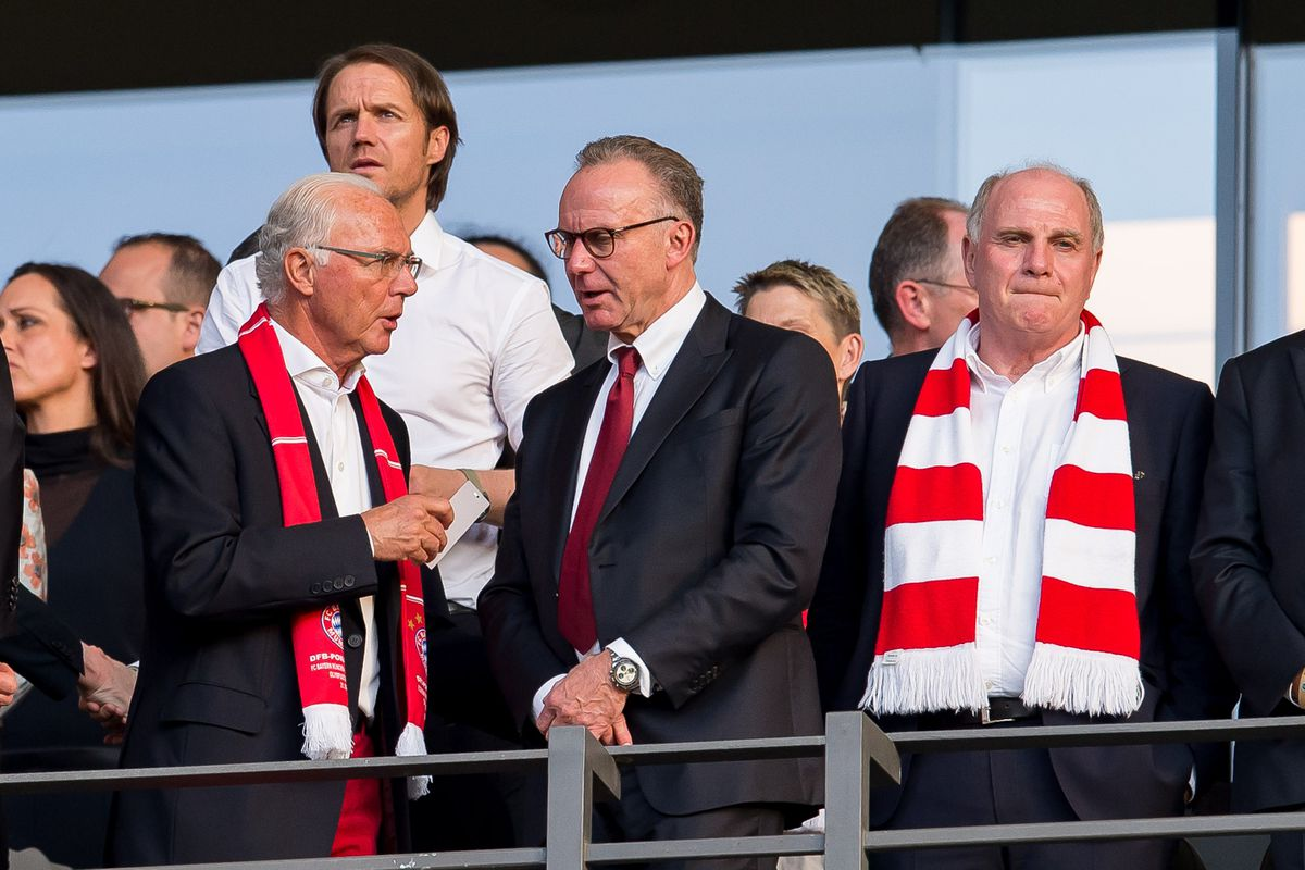 Bayern Muenchen v Borussia Dortmund - DFB Cup Final 2016 BERLIN, GERMANY - MAY 21: Franz Beckenbauer talks to CEO Karl-Heinz Rummenigge talks to Ulli Hoeness prior the DFB Cup Final match 2016 between Bayern Muenchen talks to Borussia Dortmund at Olympiastadion on May 21, 2016 in Berlin, Germany.