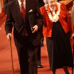 President Gordon B. Hinckley and his wife Marjorie Pay Hinckley leave the stand following the Sunday afternoon session of the 172nd semi-annual conference of the Church of Jesus Christ of Latter-Day Saints, Oct. 6, 2002.