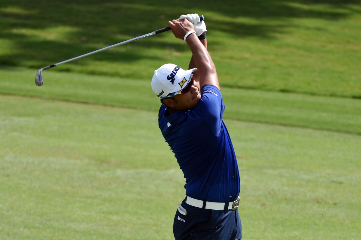 Hideki Matsuyama hits his approach shot on the ninth hole during the first round of the Wyndham Championship golf tournament.
