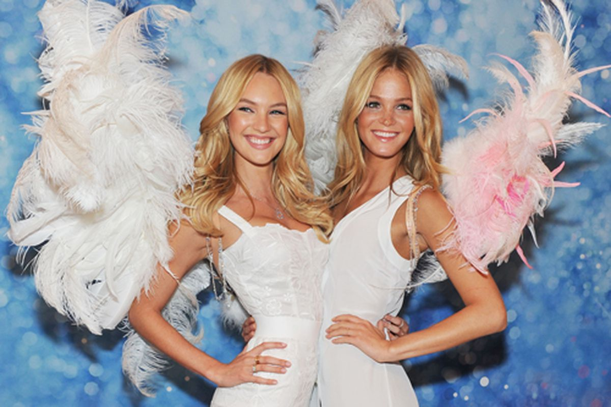 Candice Swanepoel and Erin Heatherton at last night's launch of the Angel fragrance and the Dream Angels bra at Victoria's Secret in Soho. Via Getty.