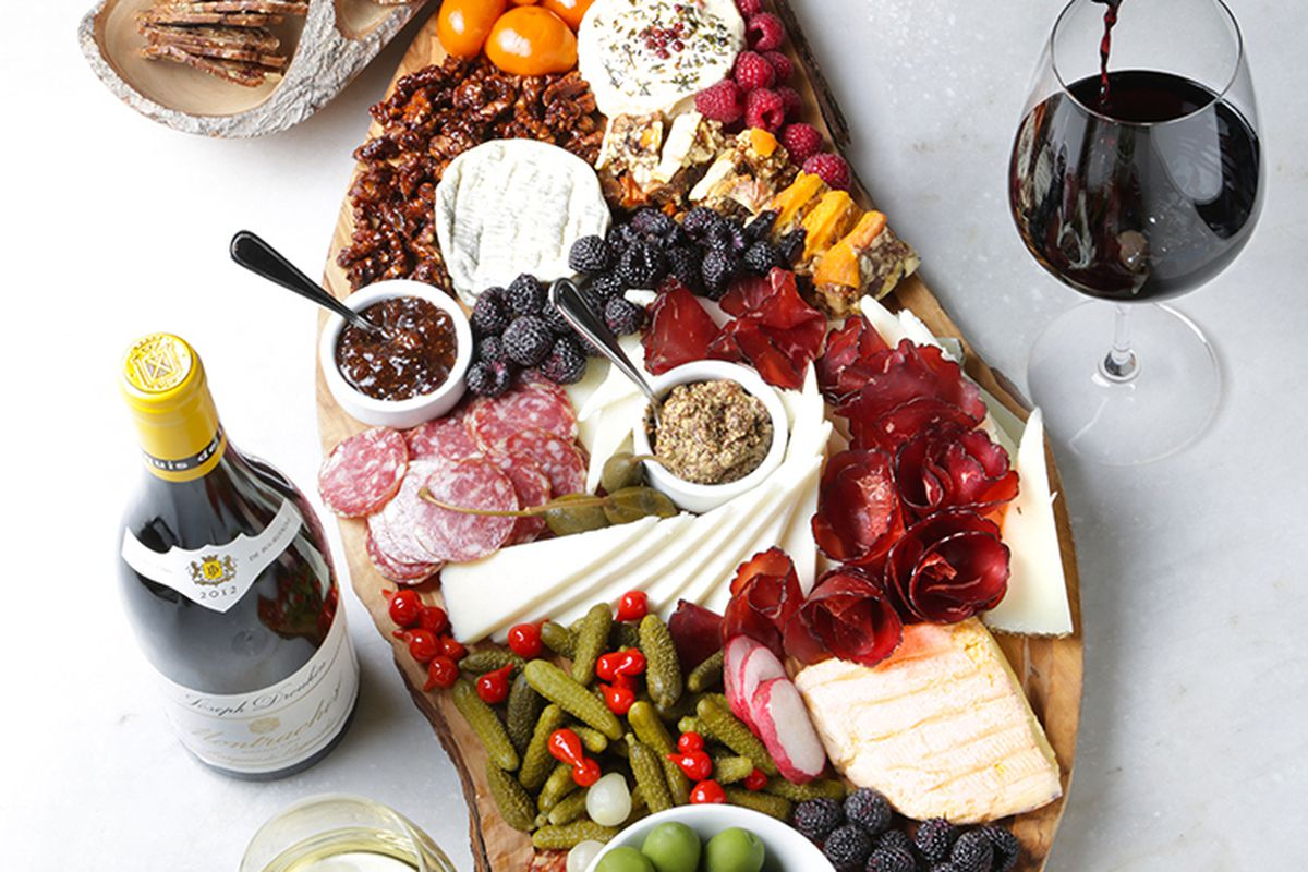 A charcuterie platter and wine