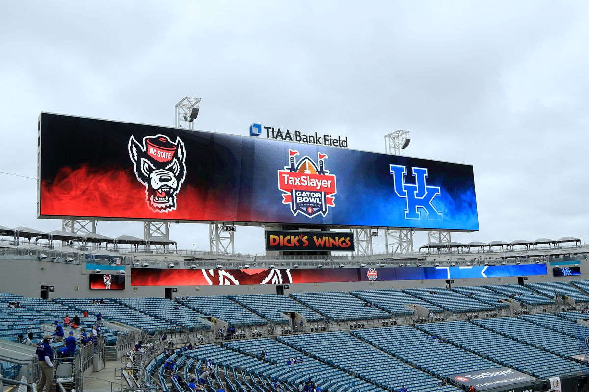 Signage is displayed for TaxSlayer Gator Bowl game between the Kentucky Wildcats and the North Carolina State Wolfpack at TIAA Bank Field on January 02, 2021 in Jacksonville, Florida.