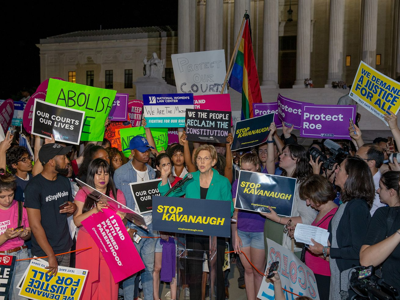 Sen. Elizabeth Warren (D-MA) speaks to activists on the steps of the US Supreme Court following the nomination of Judge Brett Kavanaugh.