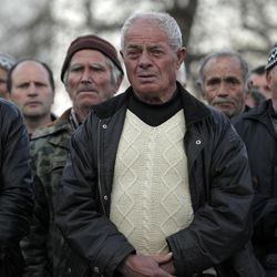 In this Wednesday, March 28, 2012 photo Bulgarian Muslims attend a commemoration ceremony for the victims of the communist repression,  39 years ago, Kornitsa, Bulgaria. On March 28, 1973 police and army units stormed the village and opened fire on hundreds at people gathered in the square to protest the communist regime's campaign to force Bulgaria's Muslims to adopt non-Islamic names and break up their communities. The brutal crackdown left five men dead and more than 100 wounded. More than 70 families were forced to leave their homes and settle in remote villages.
