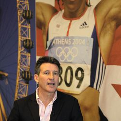 """Chairman of London Organising Committee of the Olympic Games, Sebastian Coe speaks to Associated Press at his office in Canary Wharf, London, Thursday, April 12, 2012.  With the opening ceremony just over 100 days away, Sebastian Coe is working on the final touches for the London Olympics that he hopes will make the difference between """"a good and a great games."""" At rear is a poster of former Olympic Gold medallist Kelly Holmes."""