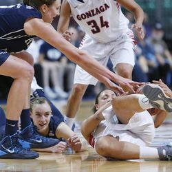 Brigham Young Cougars center Jennifer Hamson (5) and Brigham Young Cougars guard Lexi Eaton (21) and Gonzaga Bulldogs guard Haiden Palmer (3) scramble for the ball during the West Coast Conference championship game in Las Vegas Tuesday, March 11, 2014. BYU lost 71-57.