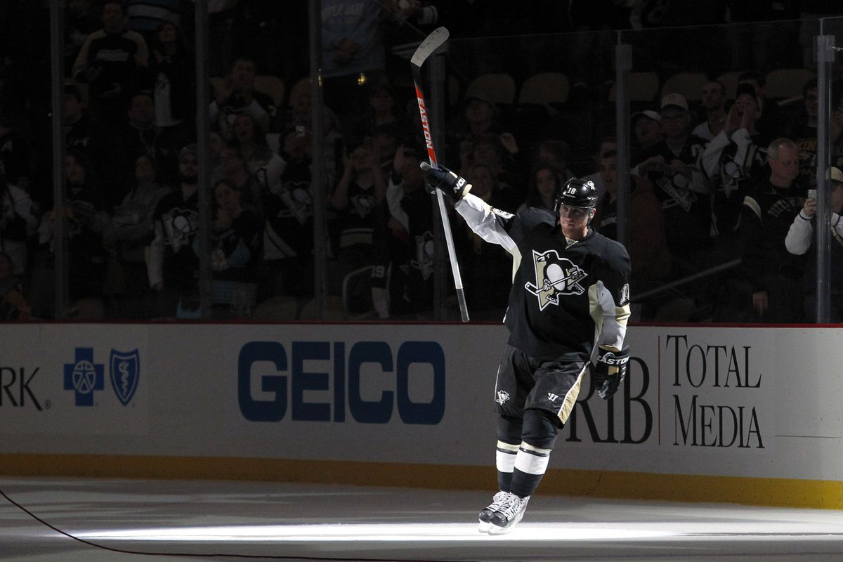 Nov 15, 2013; Pittsburgh, PA, USA; Pittsburgh Penguins left wing James Neal (18) reacts after being named the first star of the game against the Nashville Predators at the CONSOL Energy Center. The Penguins won 4-1.